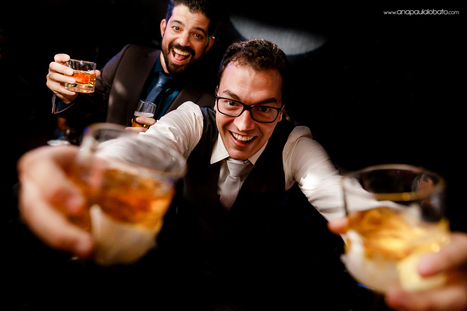 Happy groom with double drinks in an unique moment