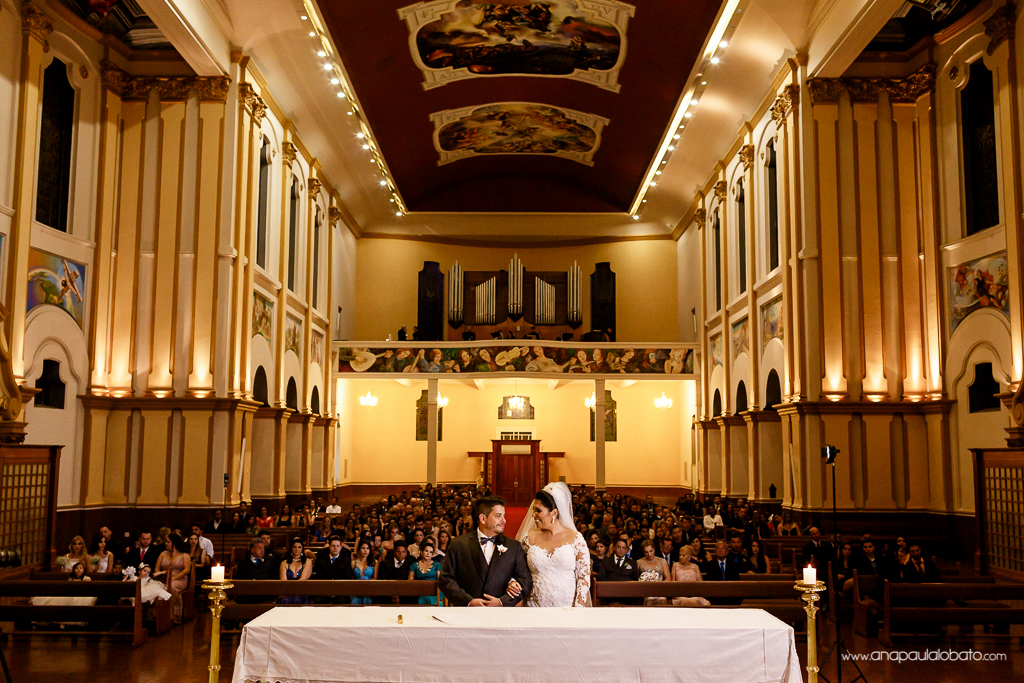 Couple look at each other in gorgeous church wedding