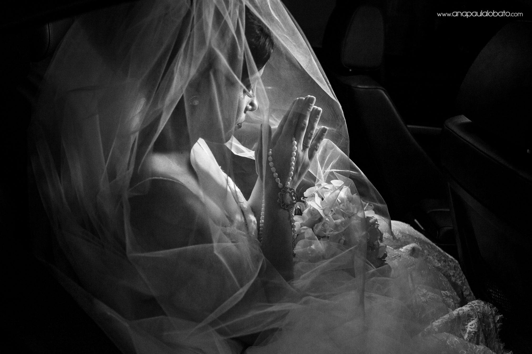 Bride prays before church wedding