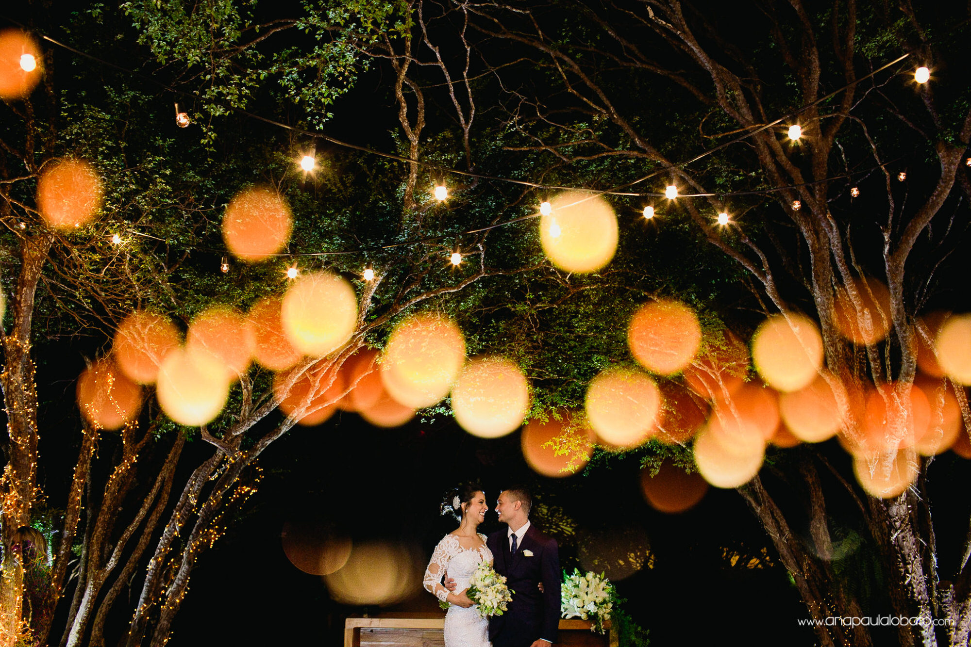 Wedding couple in the altar surrounded by little lights