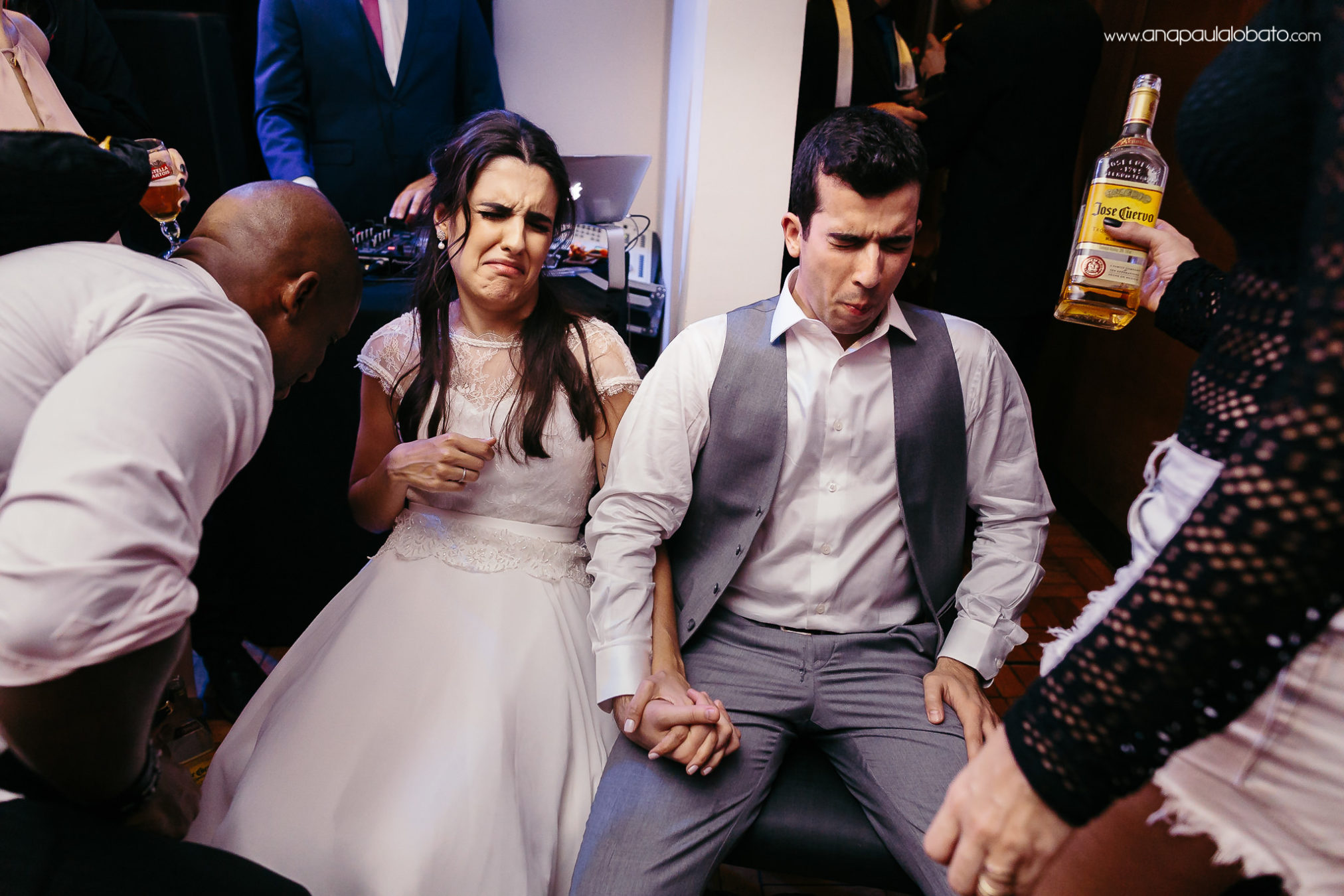 Wedding couple drinks tequila and makes a funny face