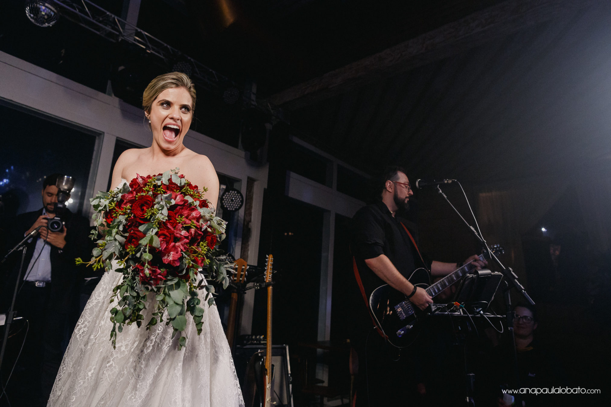 Bride gets excited with bouquet toss time