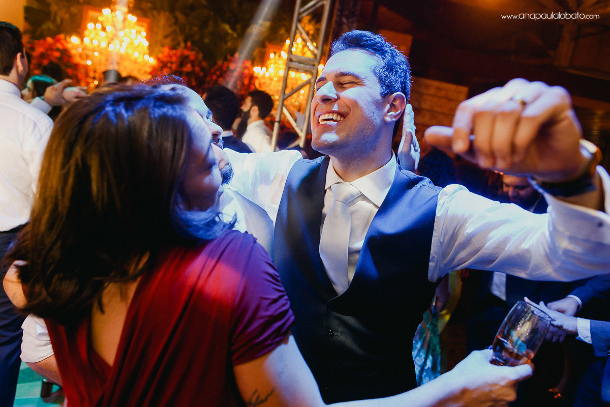 happy groom dancing with mum