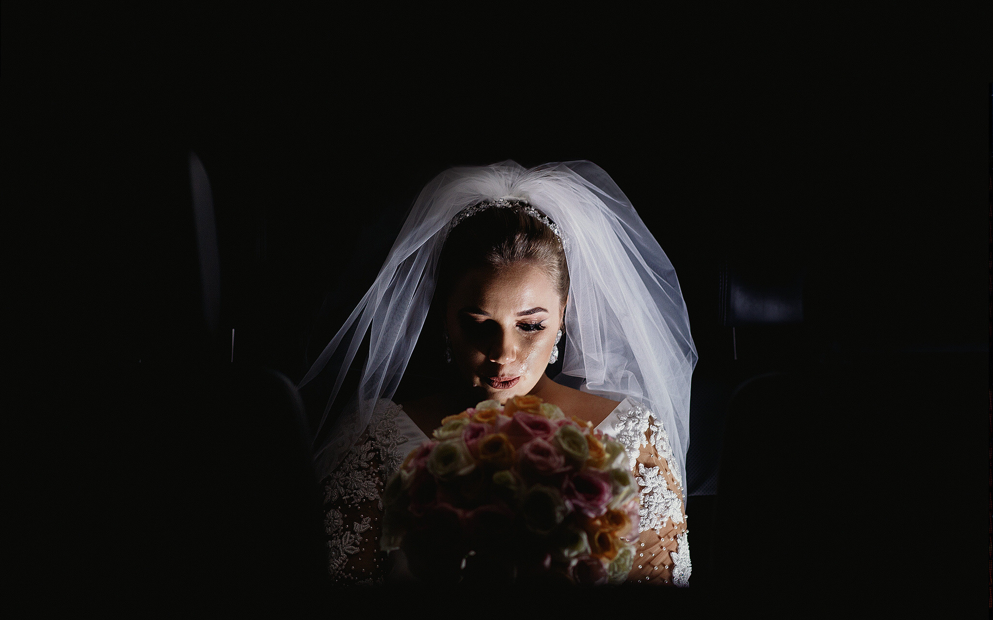emotional bride in the car